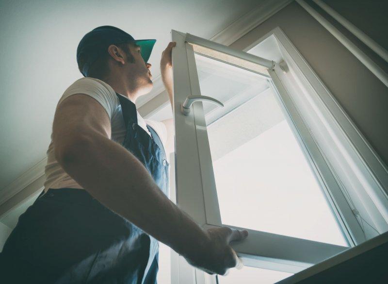 canva-professional-handyman-installing-window-at-home