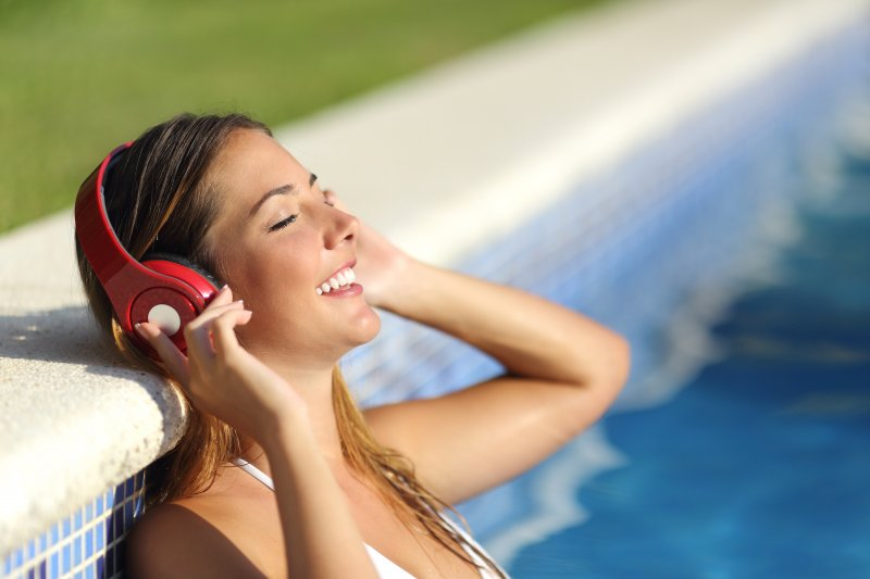 canva-relaxed-woman-listening-to-the-music-with-headphones